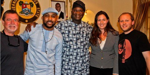 The Governor of Lagos State Babatunde Raji Fashola, R&B singer Banky W of Empire Mates Entertainment with IRI and USAID Crew members when Banky W interviewed the Governor at the State House in Lagos for a USAID do