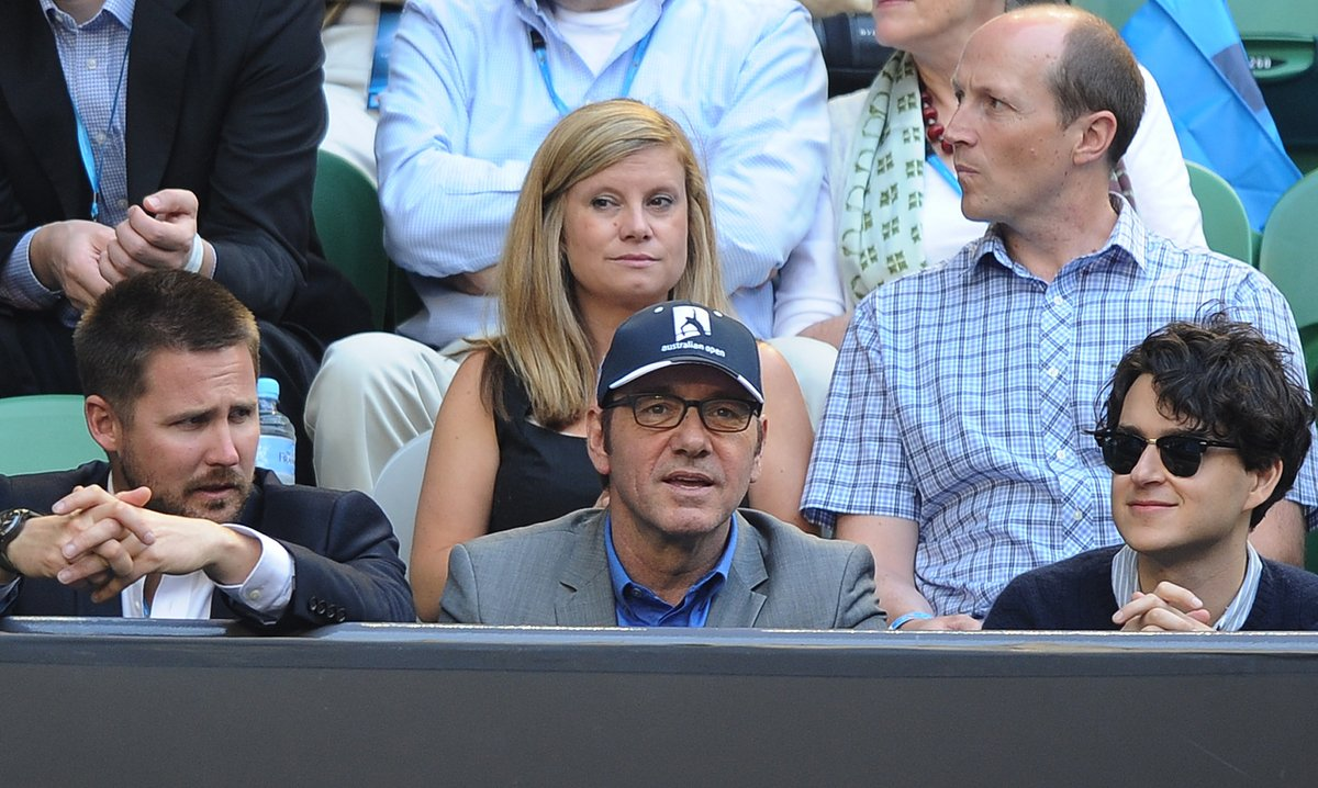 US actor Kevin Spacey, front centre, watches the the women's final between Victoria Azarenka of Belarus and China's Li Na