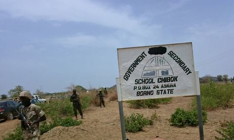 Soldiers stand guard in front of the school in Chibok, Nigeria