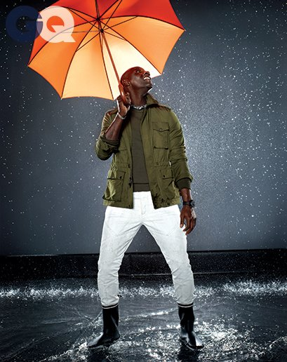 1399650580343_omar-sy-gq-raincoat-gq-magazine-may-2014-fashion-style-men-weather-04
