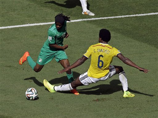 Gervinho floors a Columbian defender on his way to scoring his super goal