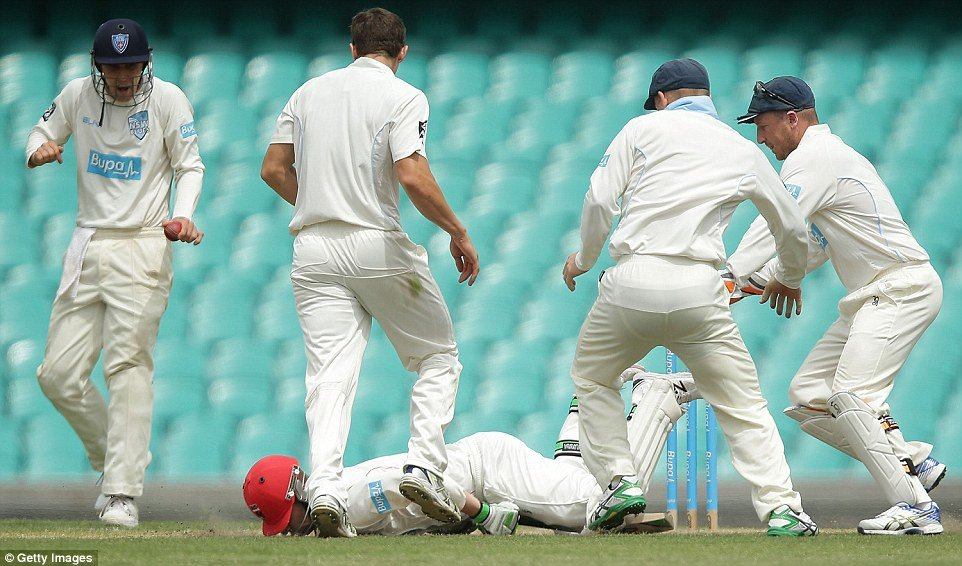 Phillip Hughes collapsed to the floor after he was struck