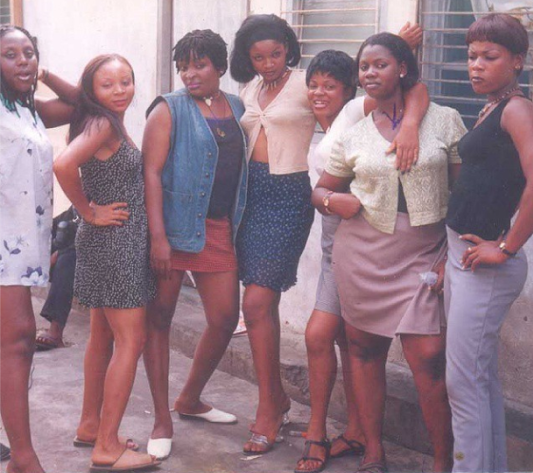 Young Omotola Jolade in the middle